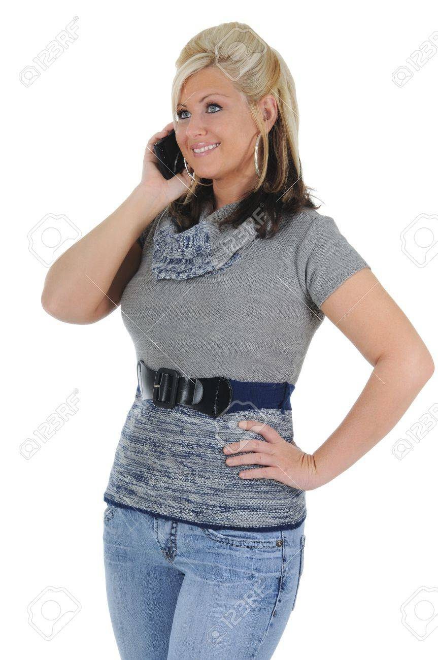 A attractive young blonde woman having a conversation on her smart phone. Isolated on a solid white background. - 10282352
