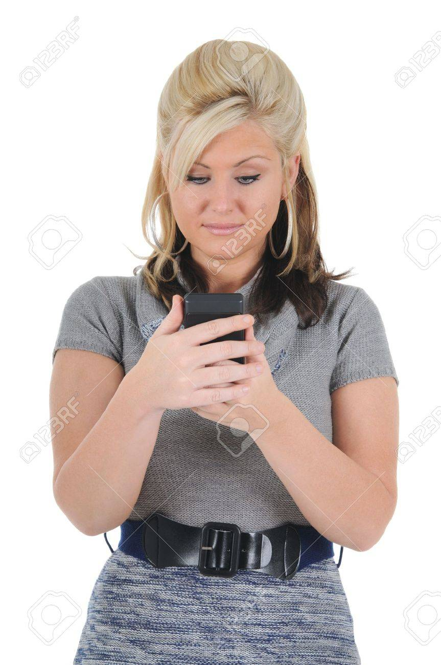 A attractive young blonde woman reading a text message on her smart phone. Isolated on a solid white background. - 10413334