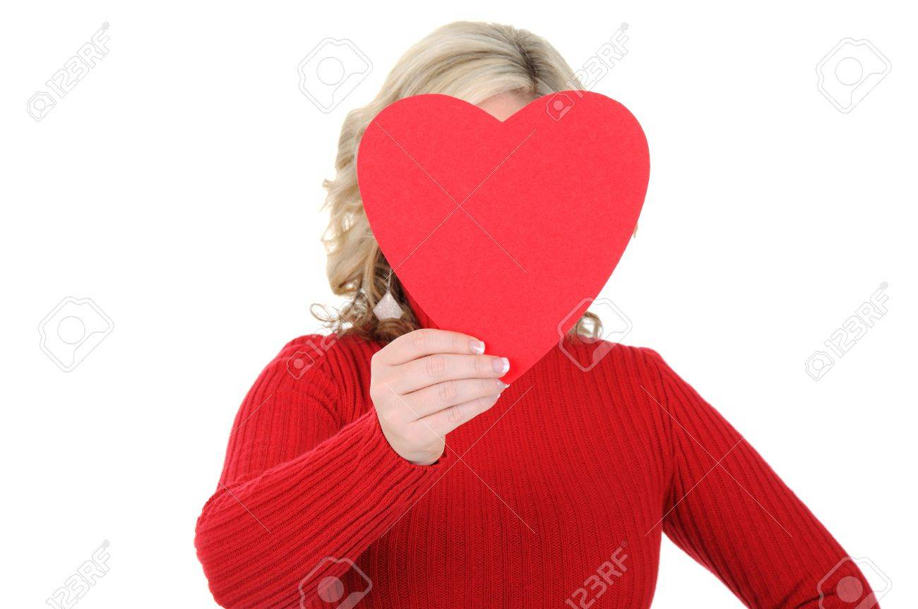 A charming young woman holding a paper heart. Valentine's Day concept. Isolated on a solid white background. - 11889962