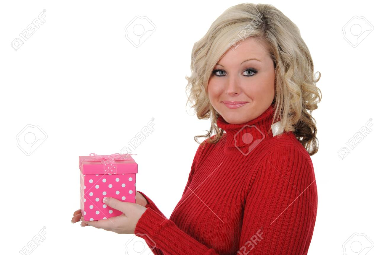 A charming young woman holding a pink gift box. Valentine's Day concept. Isolated on a solid white background. - 11976935