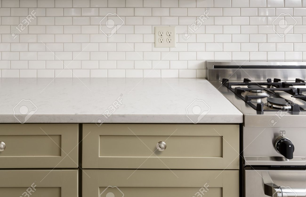 subway tile kitchen counter with subway tile stainless steel oven stove shaker cabinets