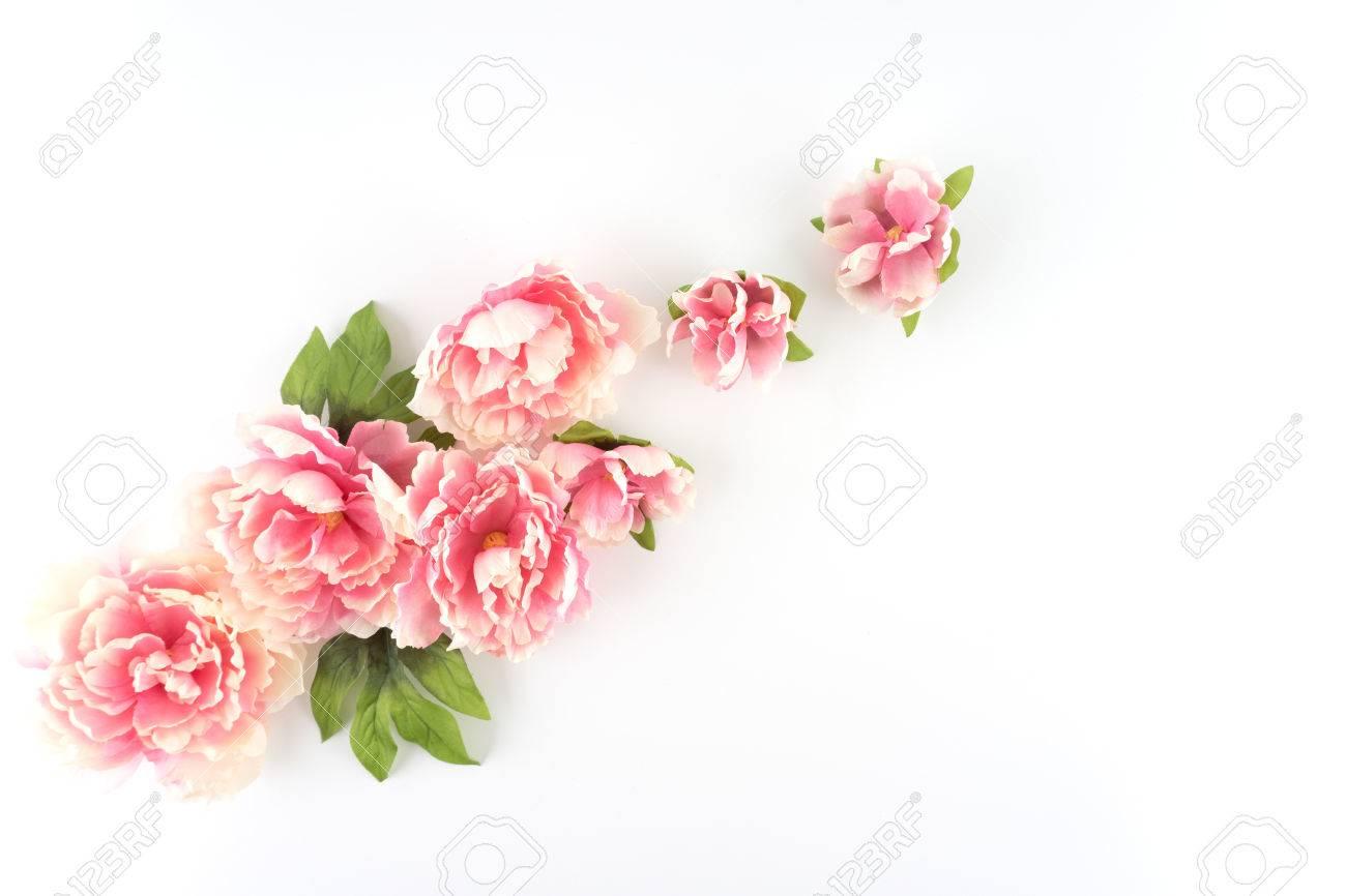 Pink peony flowers diagonal white styled desktop silk artificial pink peony flowers diagonal white styled desktop silk artificial flowers crafts stock photo mightylinksfo