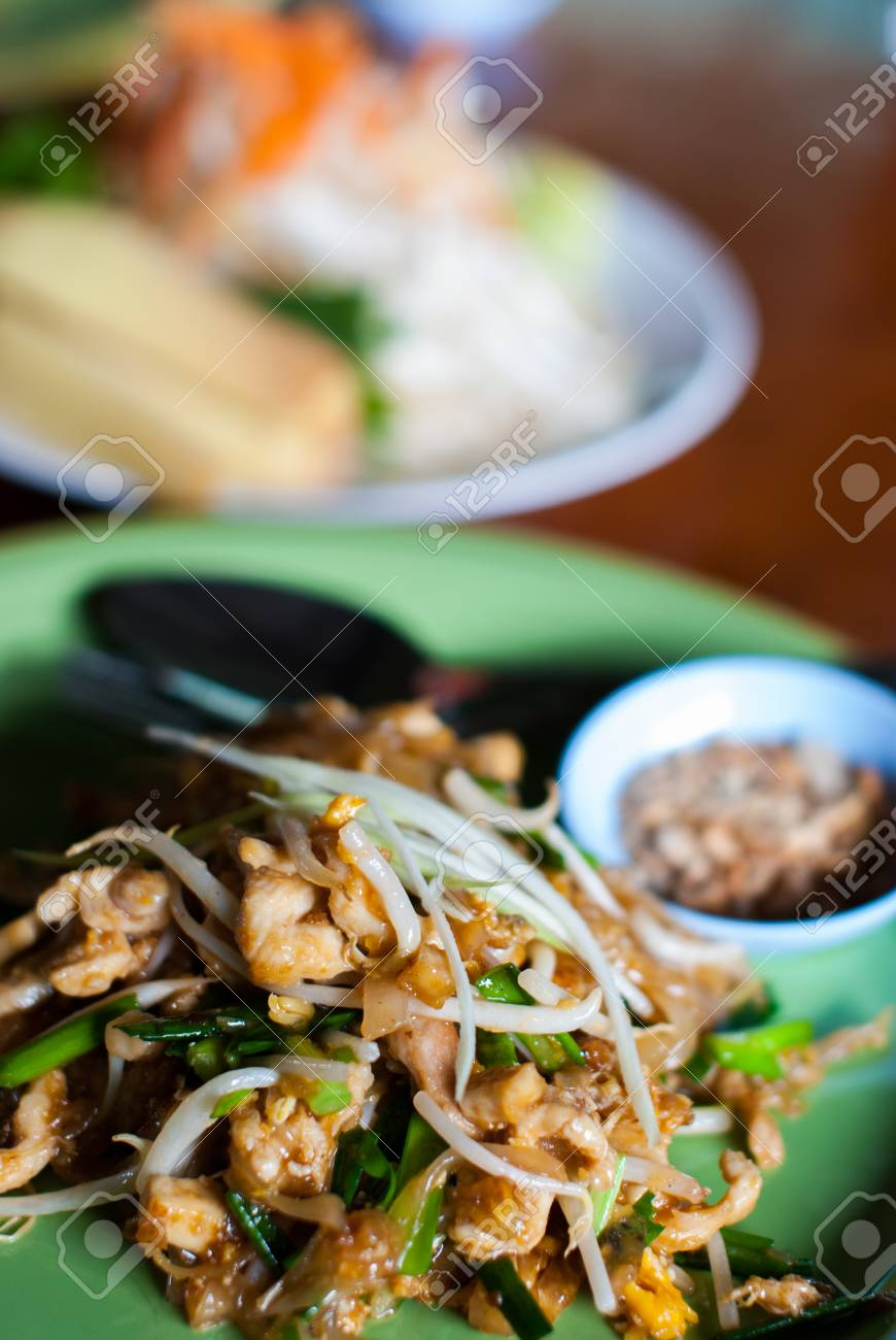 Pad thai with chicken and pork in dish at restaurant Stock Photo - 23955347
