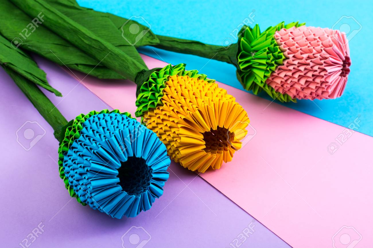 Multicolored Paper Origami Flowers On Pastel Background Studio