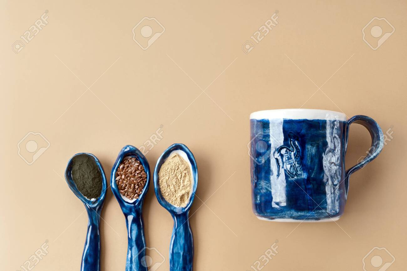 Three Blue Ceramic Clay Handmade Spoons With Flax Seeds Chlorella Stock Photo Picture And Royalty Free Image Image 136634030