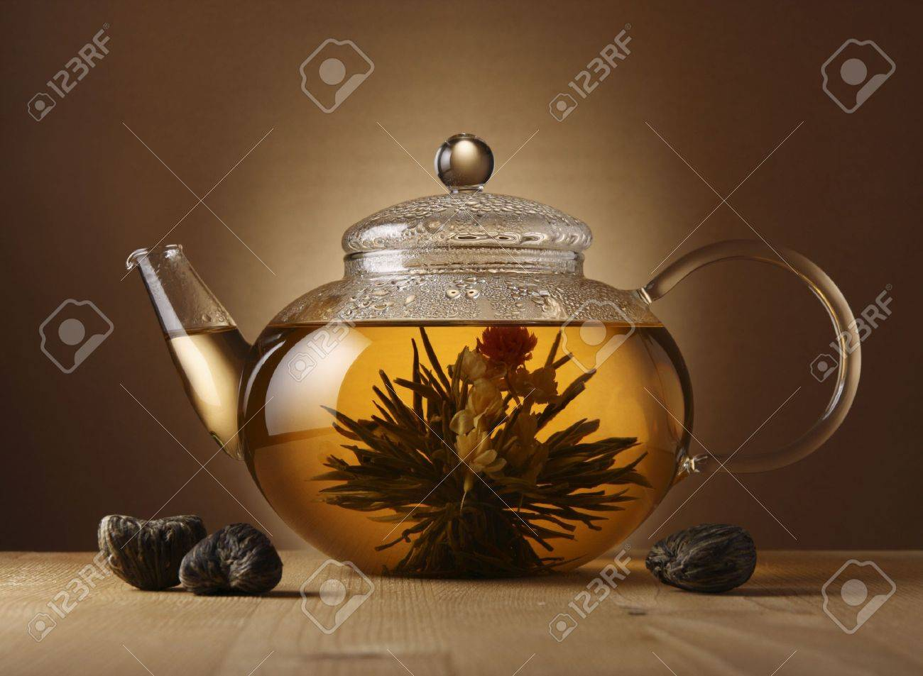 A glass teapot with lotus flower chinese tea stock photo picture a glass teapot with lotus flower chinese tea stock photo 2951599 izmirmasajfo