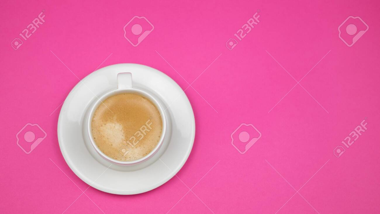 A cup of black coffee on pink background. View from above. copy space. - 138231619