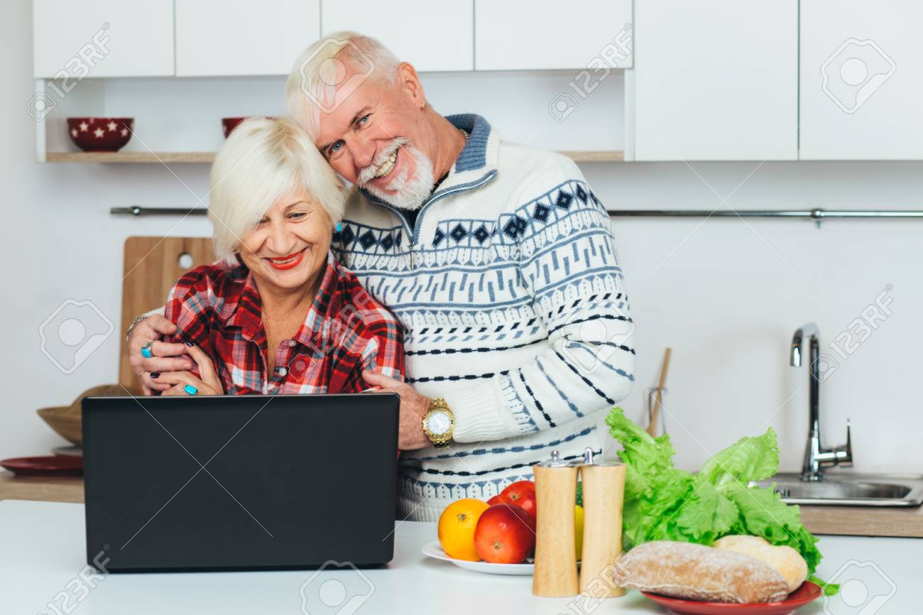 Elderly man and woman are looking for a recipe in a laptop elderly man and woman are looking for a recipe in a laptop preparing healthy food forumfinder Choice Image