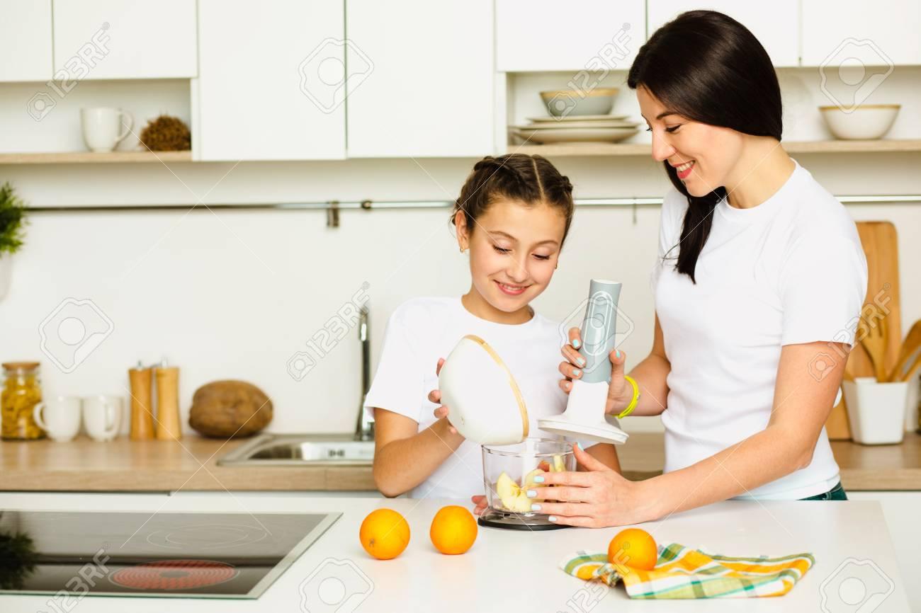 Daughter Helps Mom Prepare Breakfast, Mixing Fruit In A Blender ...