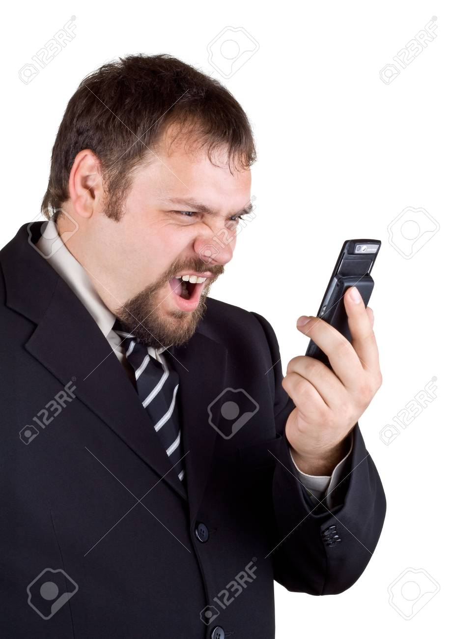Businessman shouting into a mobile phone, isolated on white Stock Photo - 10747706