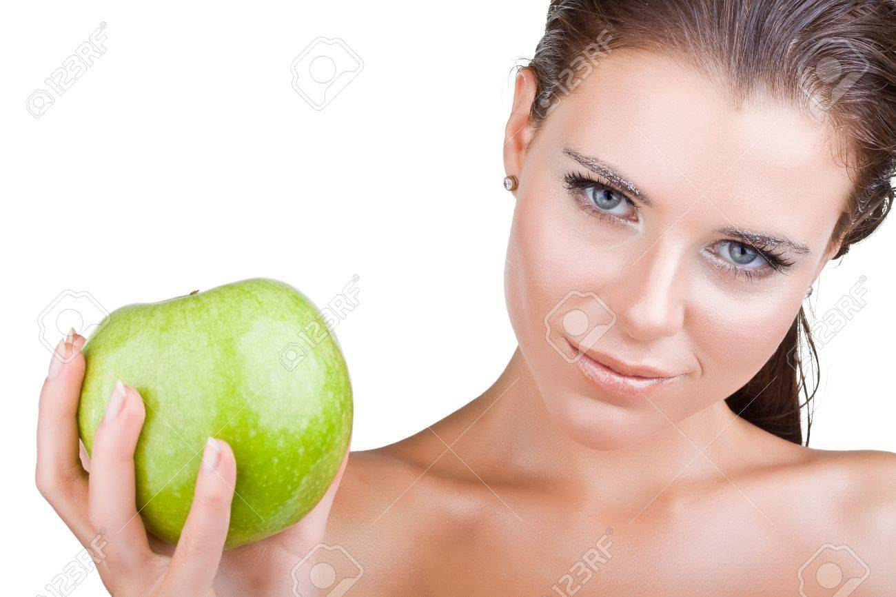 Beautiful girl holds in a hand green apple, isolated on white background Stock Photo - 11766937