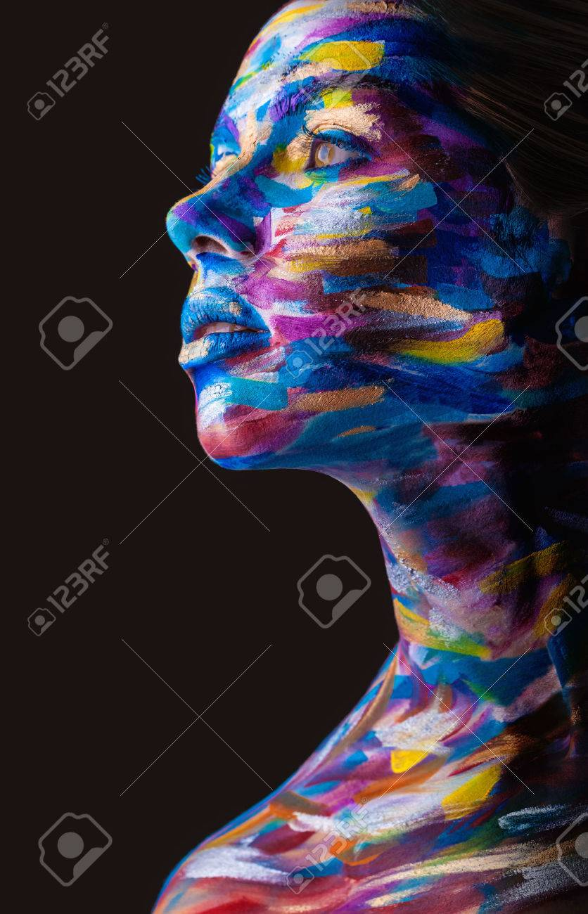 Young woman with colorful makeup and body art on a black - 38703219
