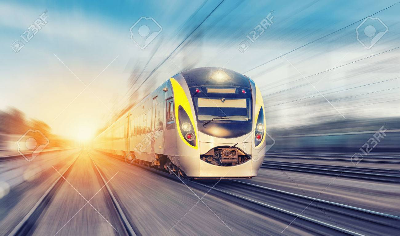 Modern high speed train on a clear day with motion blur - 46649818