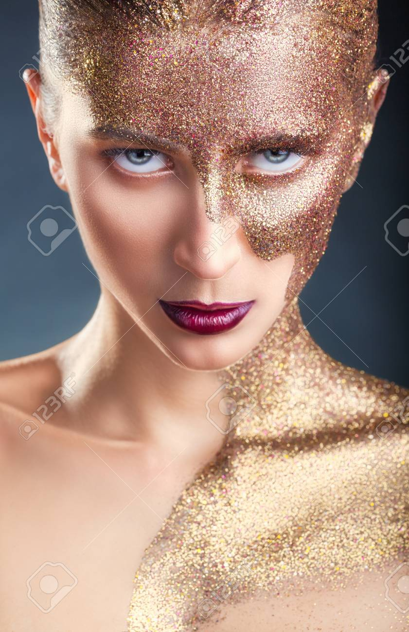 99f9ffe23b245 Portrait of a young woman with makeup fashion. Half face and..