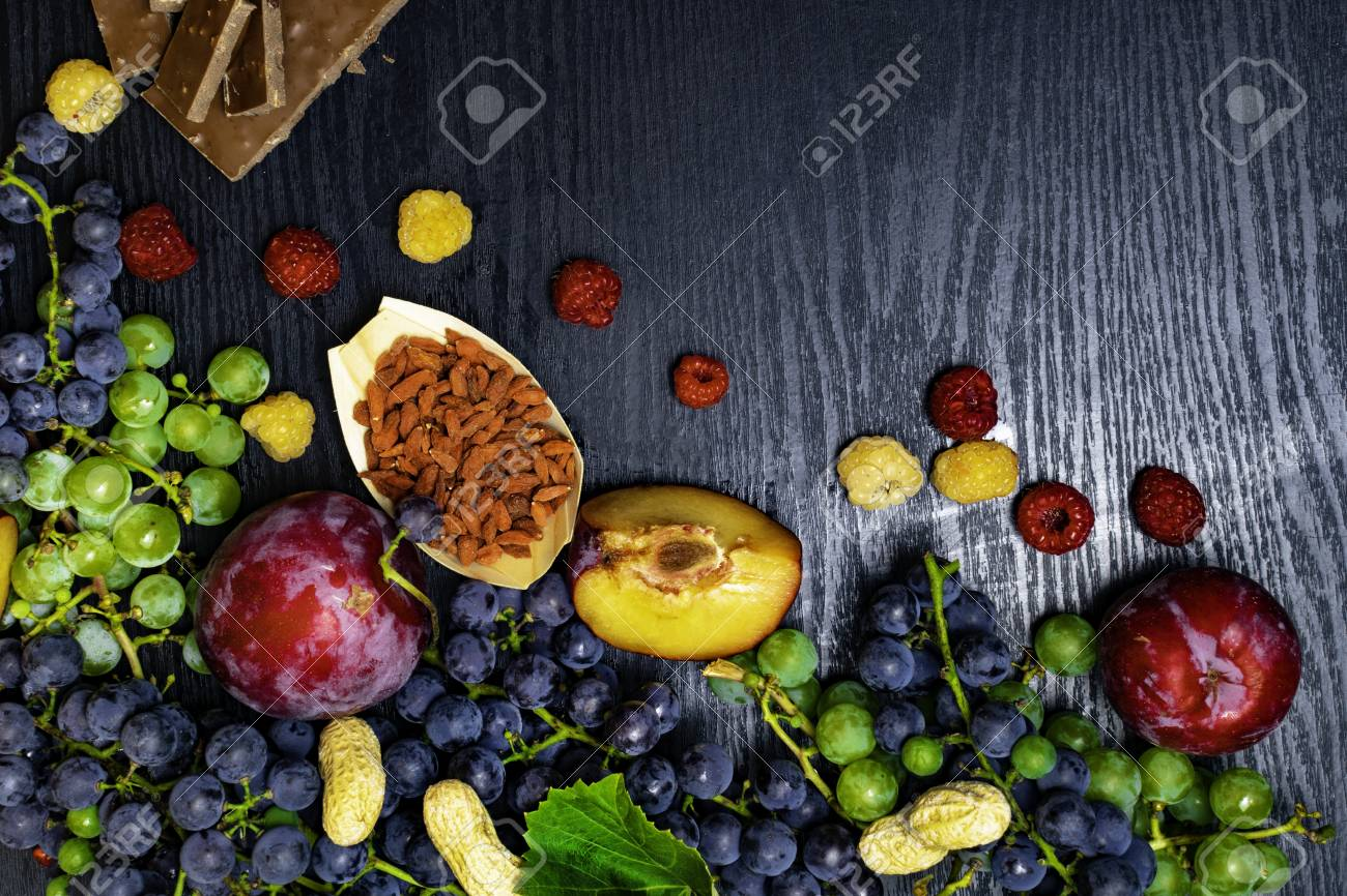 Fruits For Health Food Rich With Resveratrol Grapes Plums Stock Photo Picture And Royalty Free Image Image 107977898