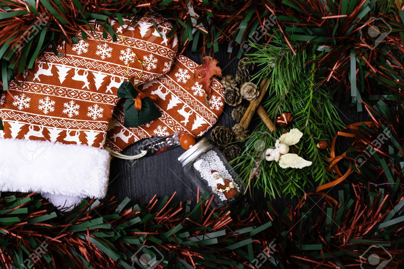 Christmas Socks With Present Gift Berry Garland Santa Claus Stock Photo Picture And Royalty Free Image Image 111033292
