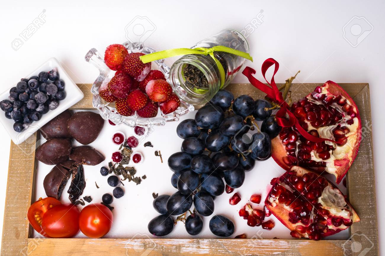 Food Rich With Resveratrol Grapes Plums Strawberry Dark Chocolate Pomegranate Stock Photo Picture And Royalty Free Image Image 113490723