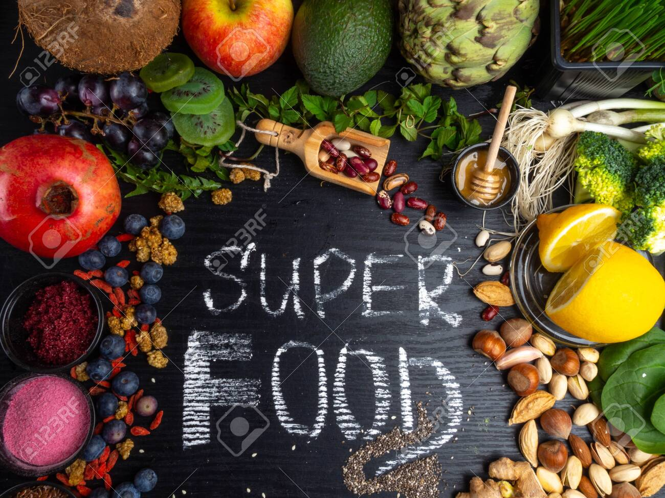 Healthy super food selection on wooden background. High in antioxidants, vitamins, minerals and anthocyanins, top view - 120919760