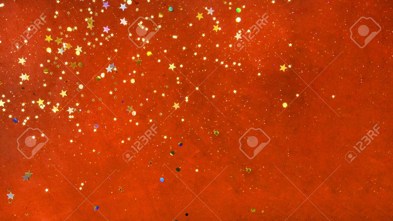 Gold stars and confetti on red velvet textural background. Holiday concept - 140759204