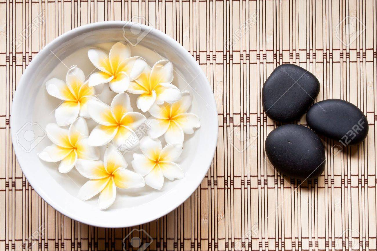 Plumeria and hot mineral stone in spa Stock Photo - 8921802