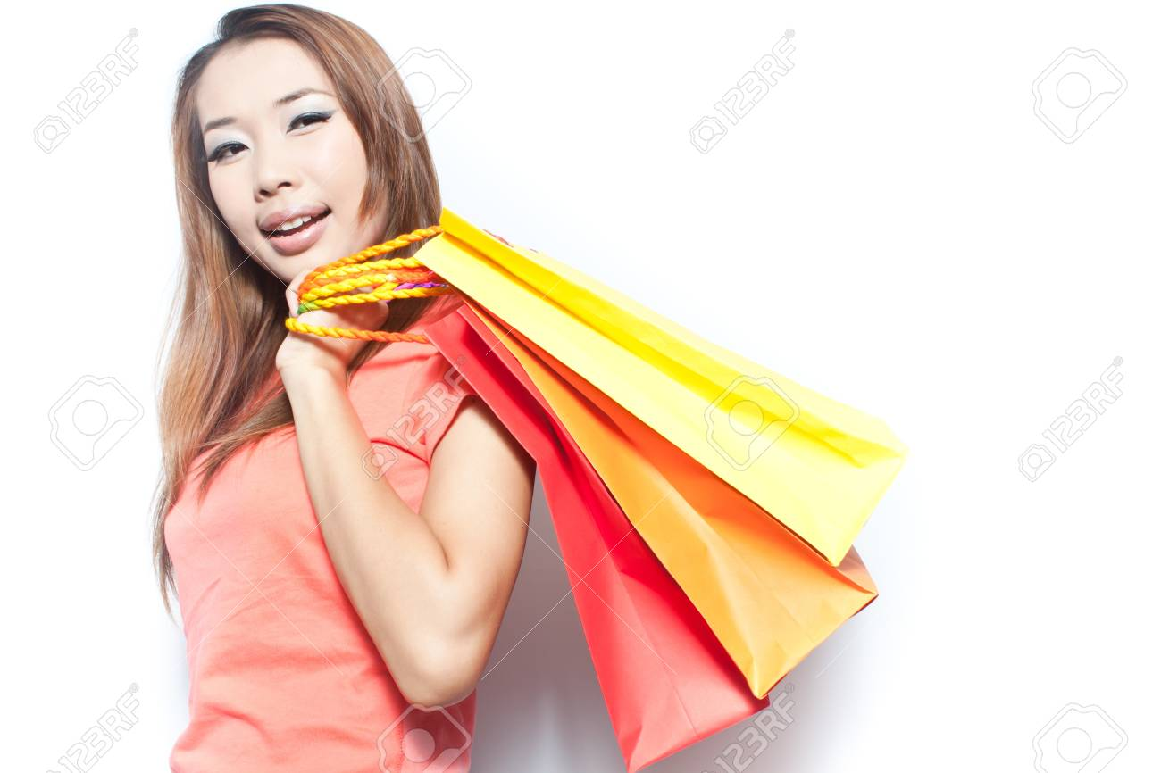Asian woman with her  shopping bags Stock Photo - 14451498