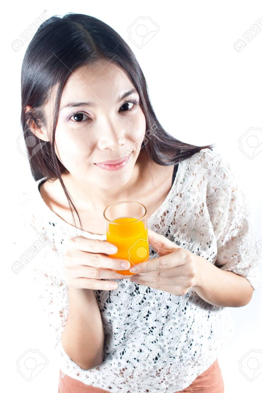 Healthy woman smiling and holding a glass of orange juice Stock Photo - 15003080