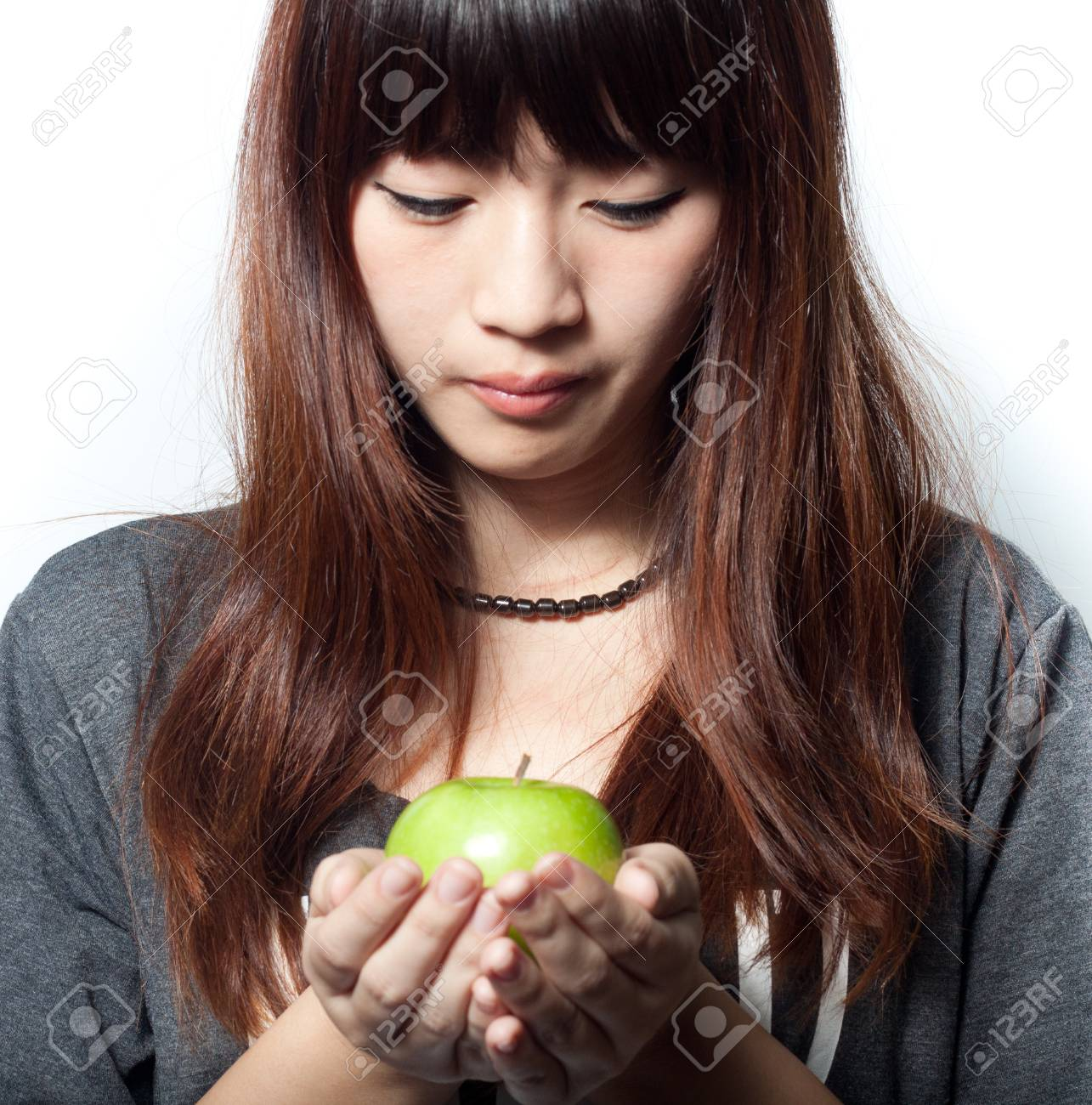 Young girl holding green apple Stock Photo - 15166132