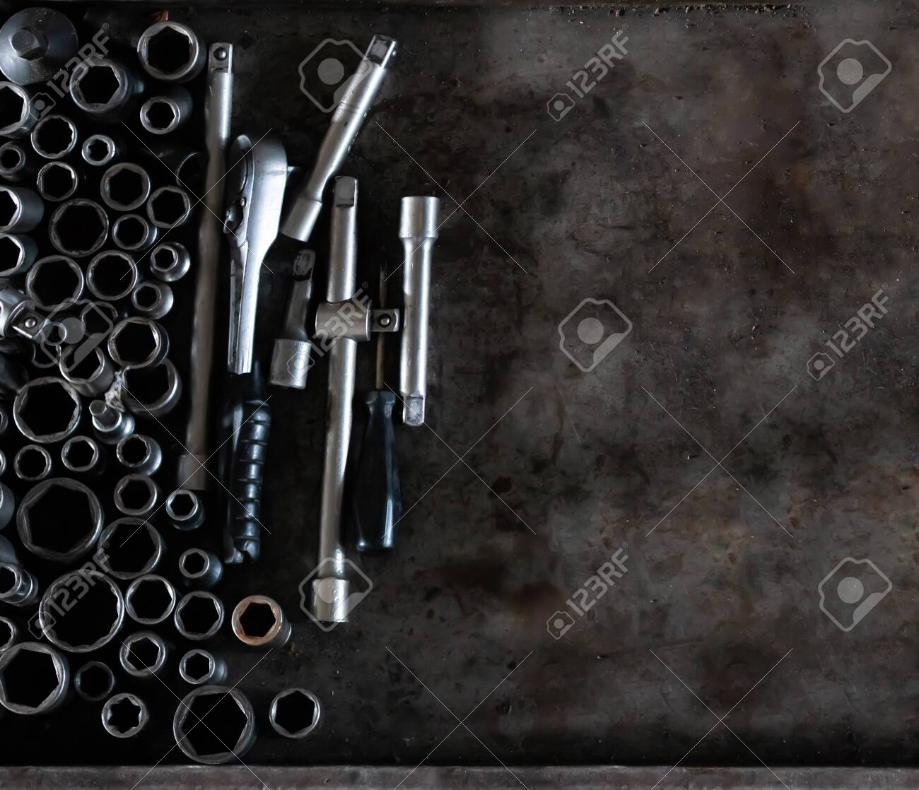 Mechanic tools set on metal background. Vintage style image of blank space on metal, lot of old tools. Copy space. Car service and repair concept. Tools on working table. - 139026700