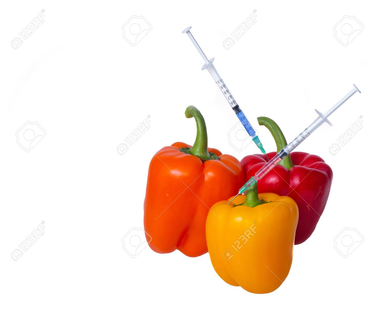 Genetically modified vegetables. GMO food concept. Syringes are stuck in vegetables with chemical additives. Injections into fruits and vegetables. Isolated on white background. - 139142225