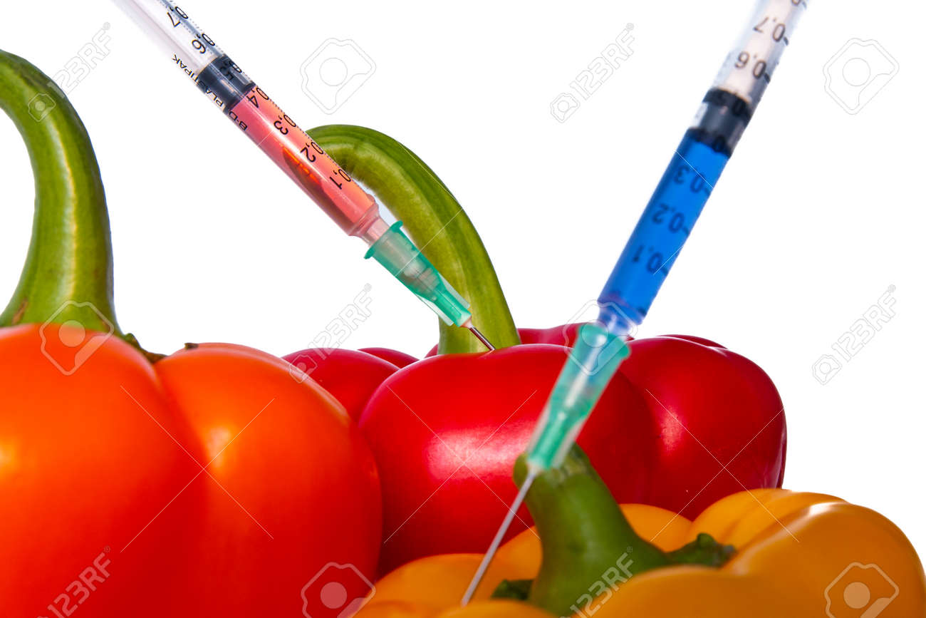 Genetically modified vegetables. GMO food concept. Syringes are stuck in vegetables with chemical additives. Injections into fruits and vegetables. Isolated on white background. - 142962922