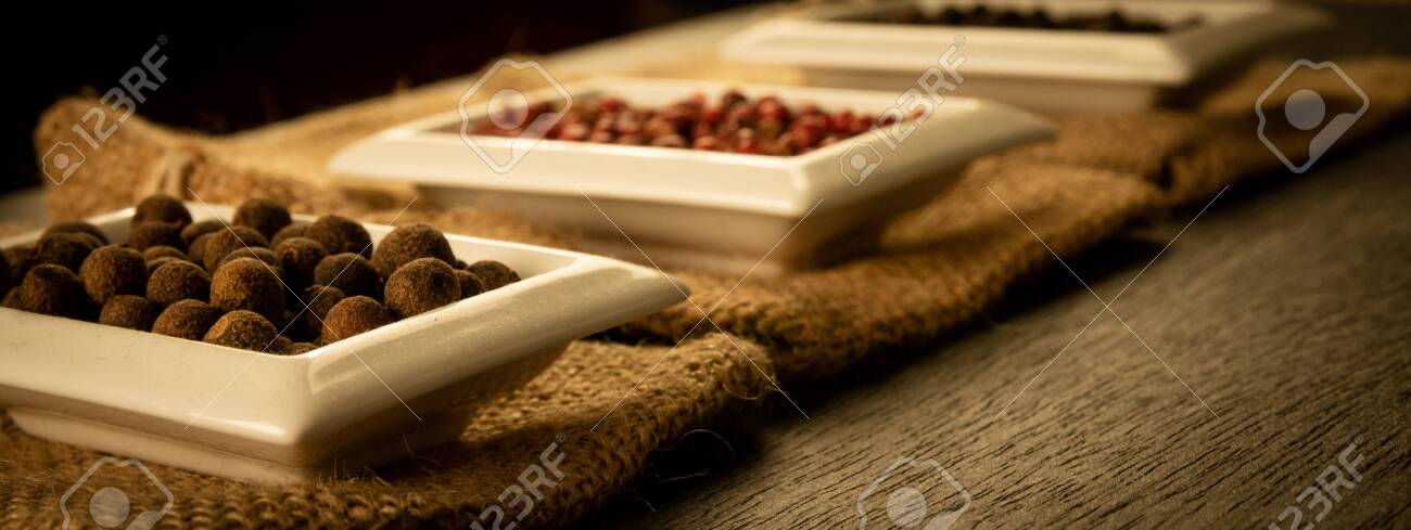 Bowl full of spices on burlap and a dark wooden background. Natural spices, vintage old seasoning theme. - 145516641