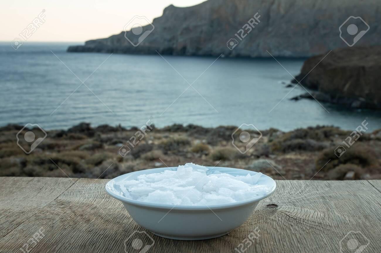 Flower of Greek sea salt crystals, south Crete. Natural traditional Fleur de sel from Crete. Sea salt flakes on wooden bakcground. - 152914484