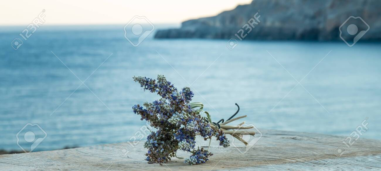 Beautiful Greek wild lavender on the background of the sea on natural wooden background. Copy space for text. Aromatherapy and essential oil concept. Space for you product. - 152914599