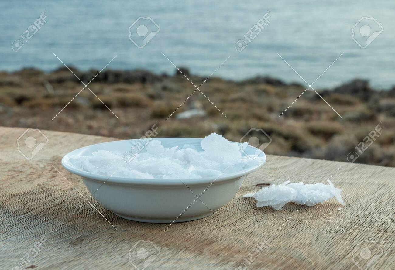Flower of Greek sea salt crystals, south Crete. Natural traditional Fleur de sel from Crete. Sea salt flakes on wooden bakcground. - 152914394