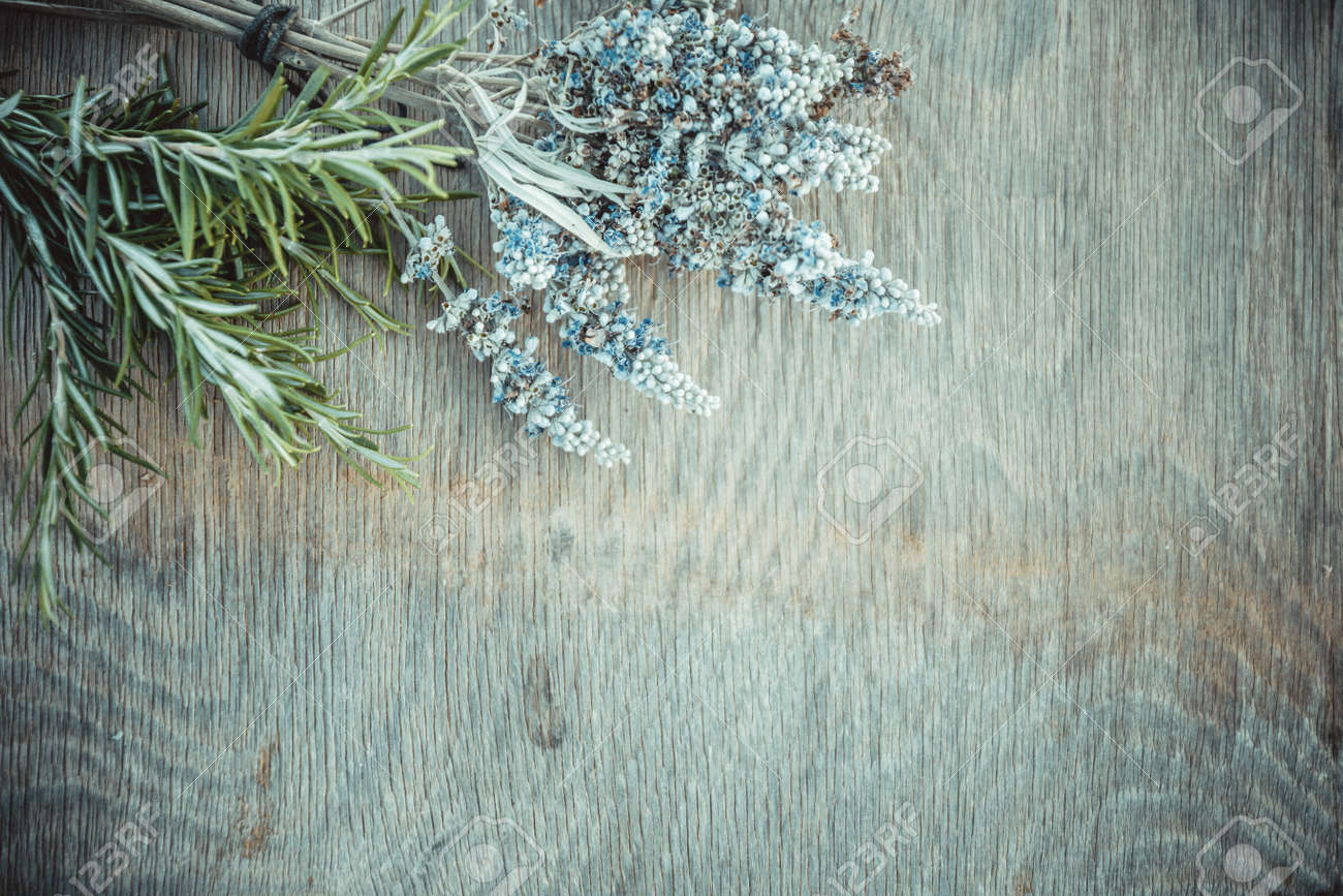 Beautiful Greek wild lavender and rosemary on natural wooden background. Copy space for text. Aromatherapy and essential oil concept. Space for you product. - 152914584