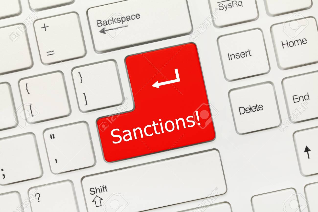 Close-up view on white conceptual keyboard - Sanctions (red key) - 122520018