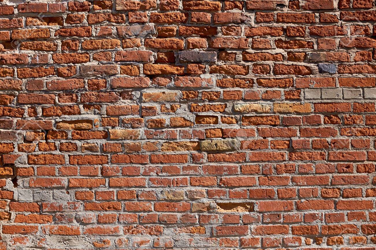 Texture of an old brick wall. Old red brick masonry. The brick background. - 144044120