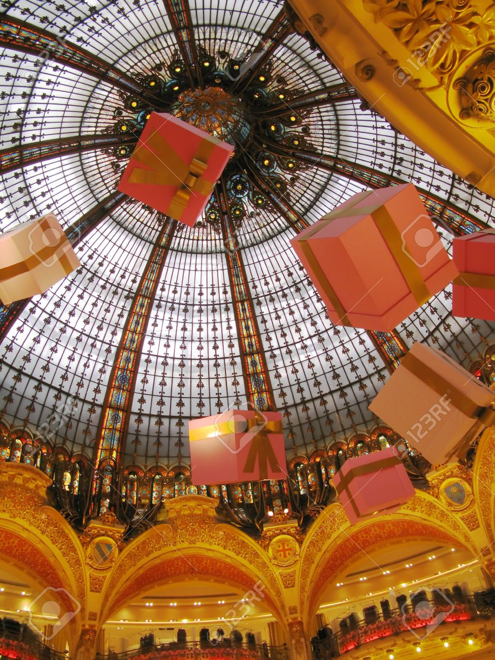 christmas decorations in the domed ceiling of department store printemps in paris holiday season 2009