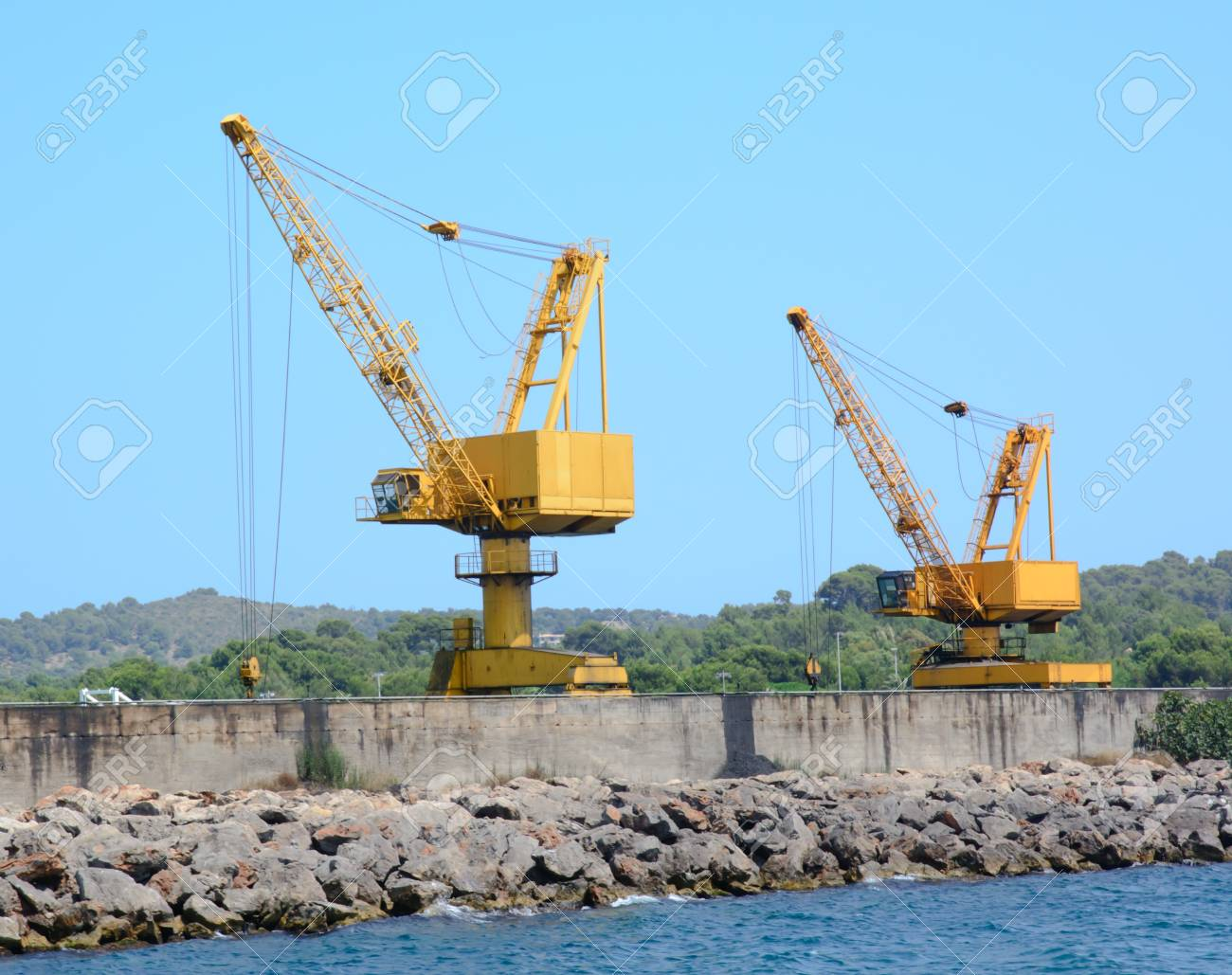 Two yellow industrial cranes on a jetty Stock Photo - 21452097
