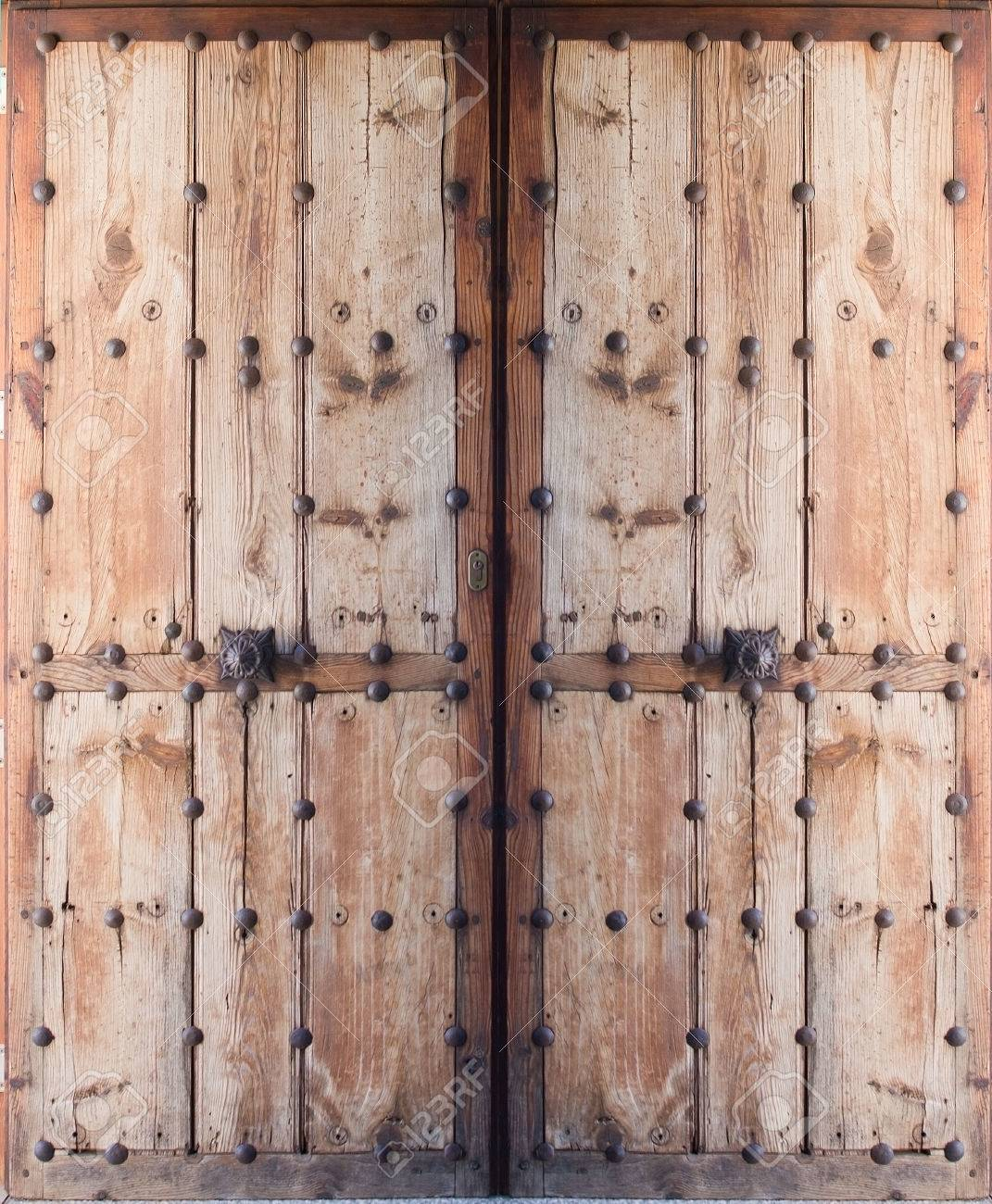 Double doors of antique wood and metal nails, Mallorca, Balearic islands,  Spain. - Double Doors Of Antique Wood And Metal Nails, Mallorca, Balearic
