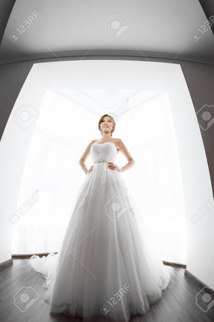 Beautiful Young Bride In White Wedding Dress Indoors. Luxuty Model ...