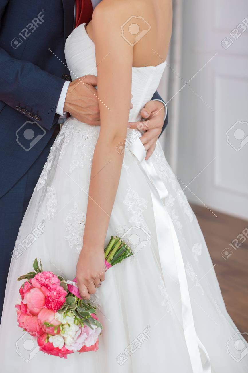 Wedding Couple Details Indoors. Beautiful Bride In White Dress ...