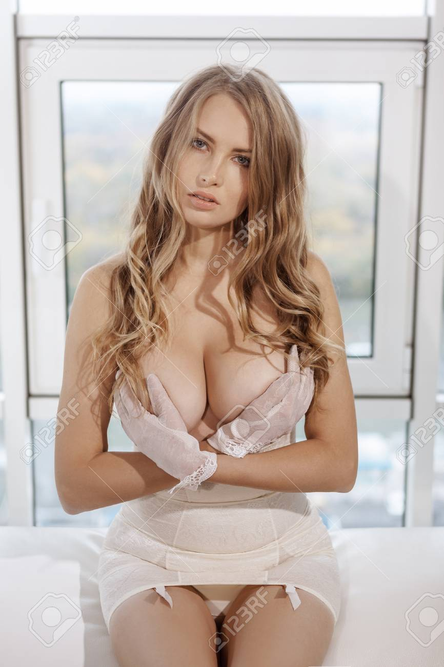 beautiful sensual blonde young girl in a sexy dress. seductive