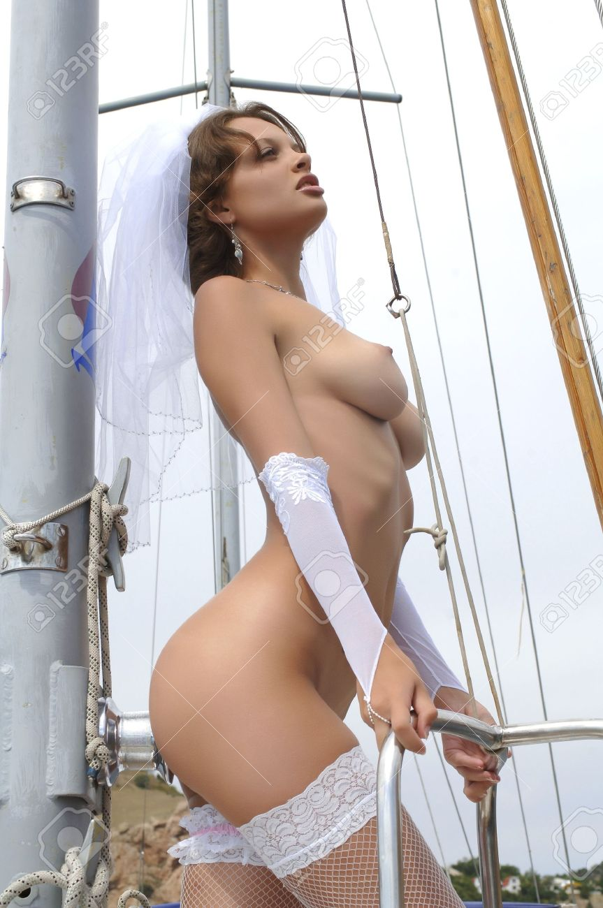 young naked woman on a yacht stock photo, picture and royalty free
