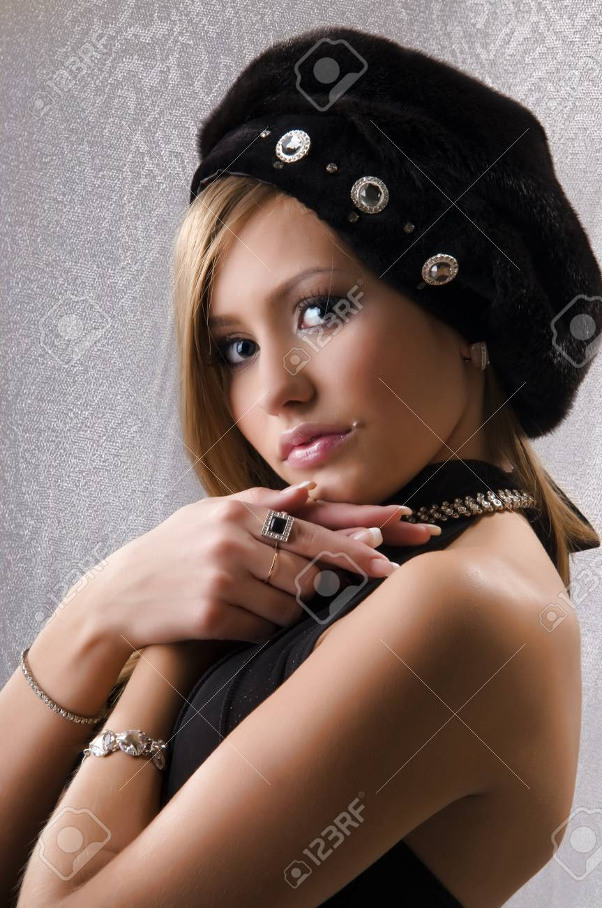 portrait of a beautiful young woman in a stylish hat Stock Photo - 9152832