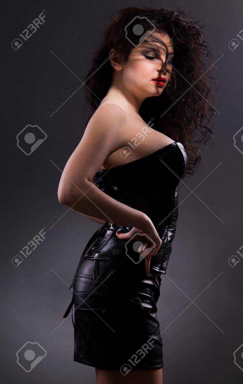 Slim sexy woman with hourglass figure in black leather corset Stock Photo - 16293447
