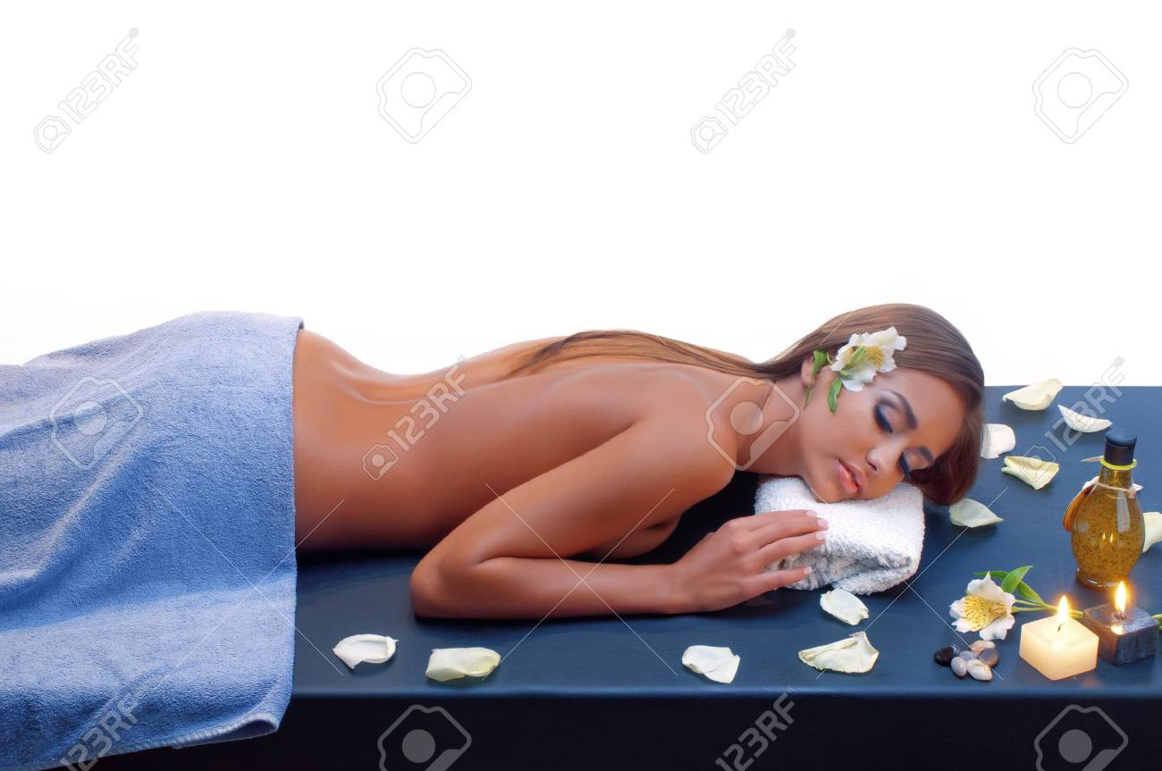 Beautiful young woman having a massage in a spa Stock Photo - 17208034