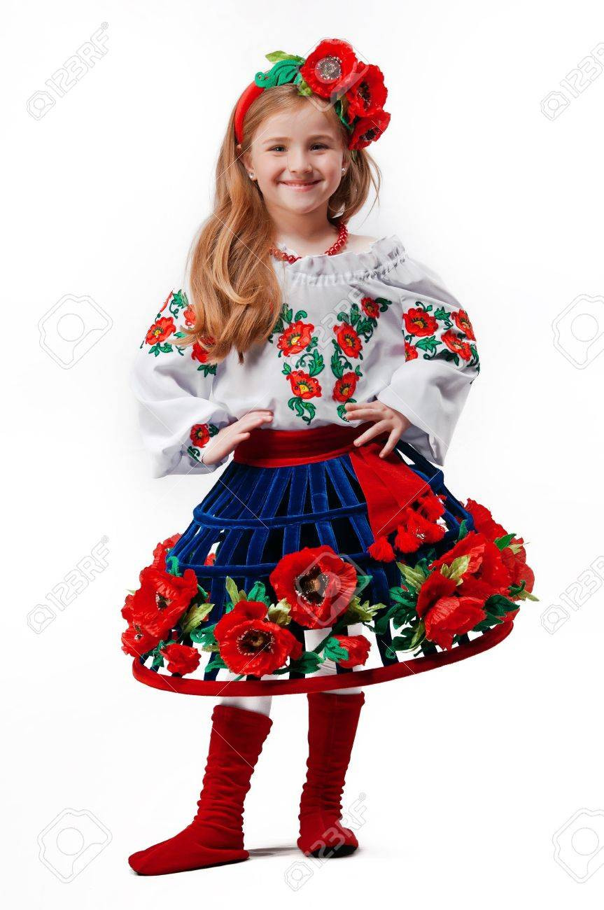 young pretty in a ukrainian national costume on a light