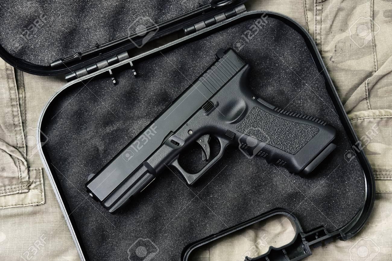 Pistol 9mm, Gun weapon series, Police handgun close-up on camouflage