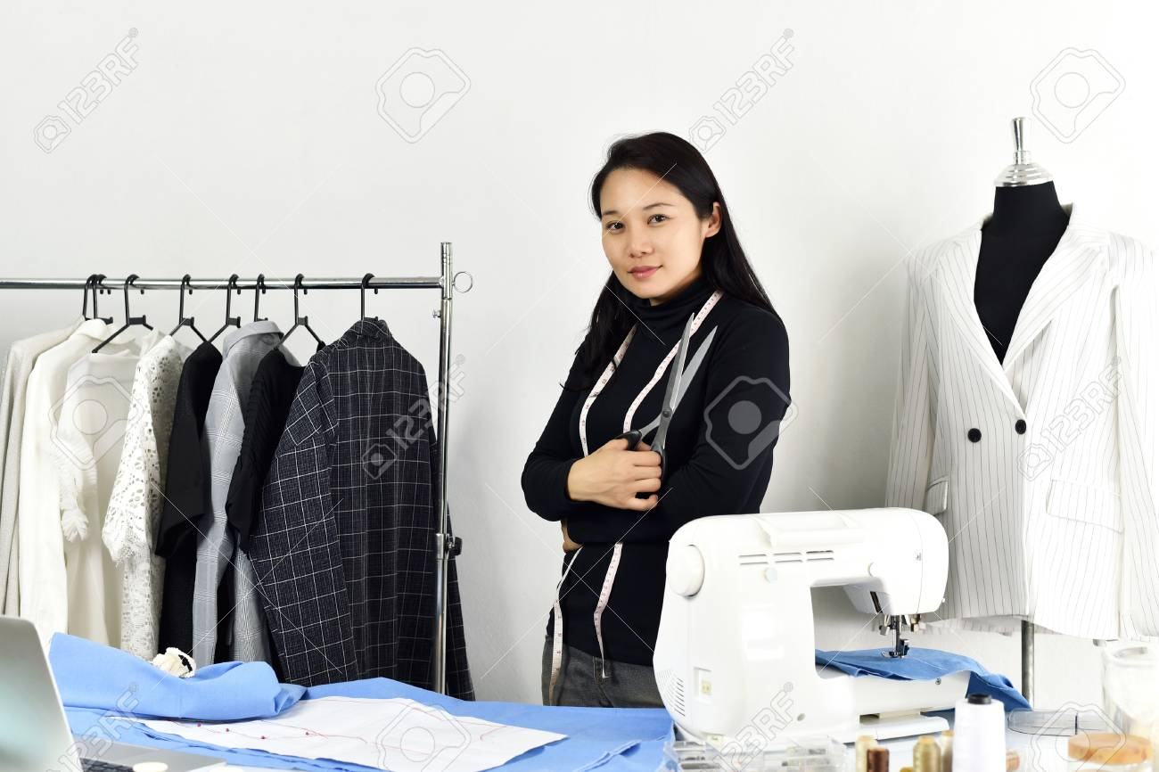 Asian Fashion Designer Working In Her Showroom Studio Female Stock Photo Picture And Royalty Free Image Image 103355021